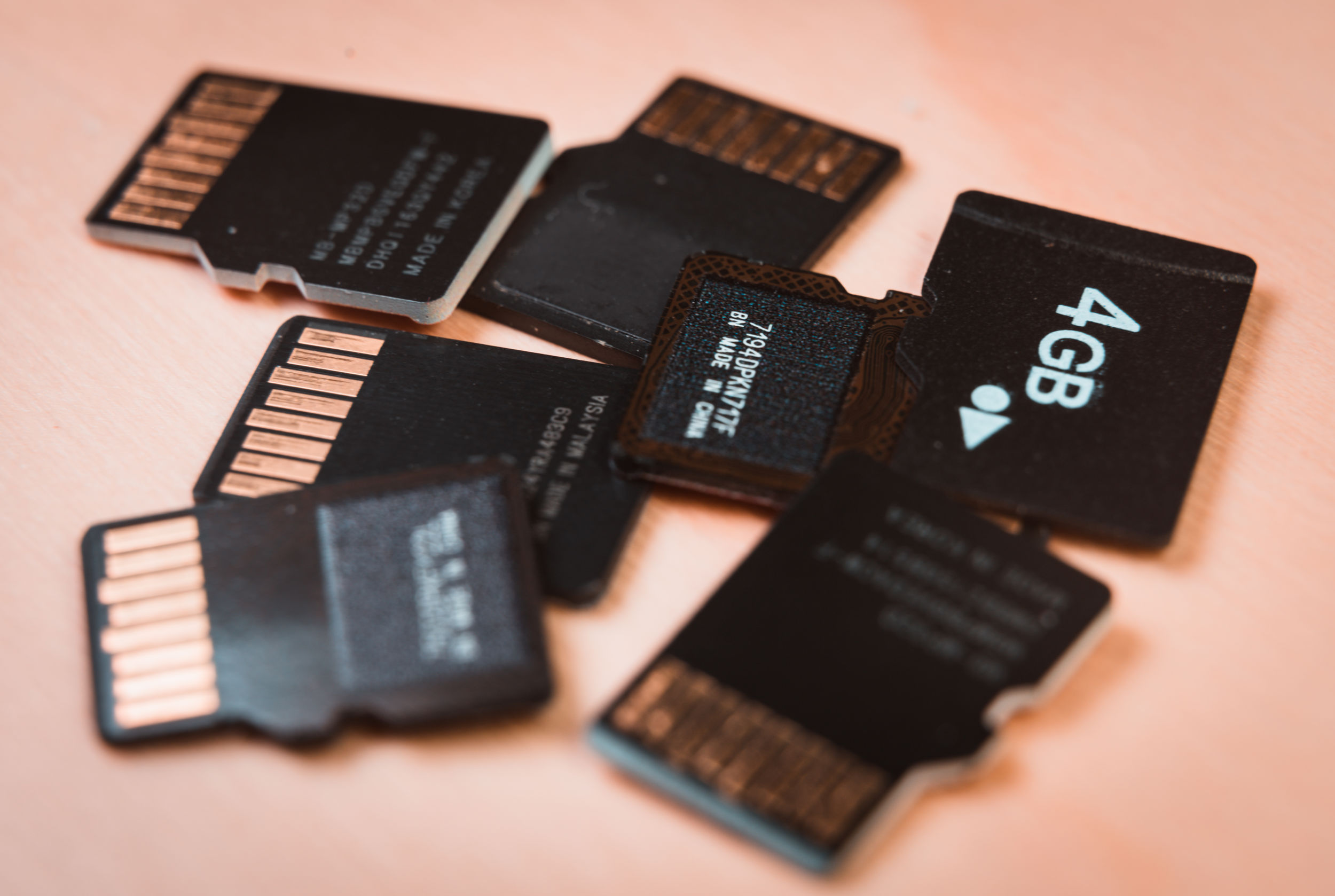 Group of MicroSD cards over a wooden table