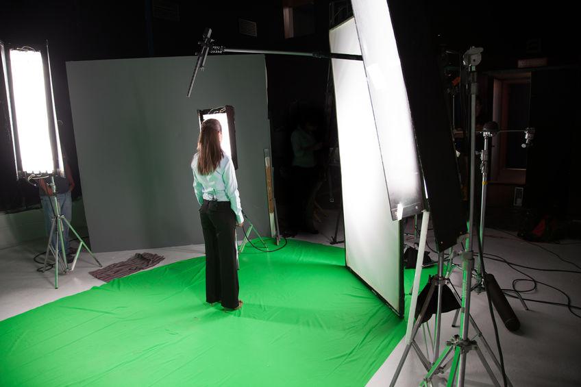 Female fashion model standing in a film studio